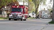 Stock Video Footage of Ambulance Responding in Town