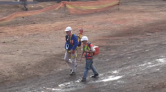 Stock Video Footage of Land Surveyor and assistant on construction site PAL