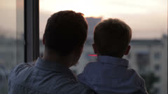 Happy father with his little son near the window Stock Footage