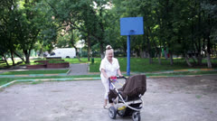 Grandmother walks with her grandson in the yard Stock Footage