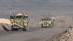 Trucks Transporting Coal on haul road NTSC - stock footage