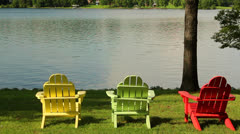 Colorful chair scenes from a lake Stock Footage