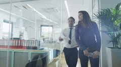 Young creative business team working together in a light contemporary office - stock footage
