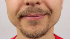 male mouth smiling, with a beard and mustache - stock footage