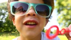 Little african american boy blowing bubbles in slow motion Stock Footage