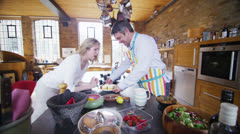 Romantic mature couple sharing cupcakes in the kitchen Stock Footage