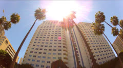 Stock Video Footage of Low Angle Driving By High Rise Condo Buildings- Long Beach CA