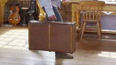 Attractive mature man with suitcase returns home after a trip Stock Footage