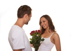 Boyfriend giving bunch of flowers to his girlfriend Stock Photos