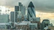 Stock Video Footage of Gherkin Building in London Timelapse pulling back Slow zoom skyscraper