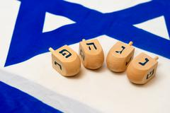 israeli flag with wooden dreidels - stock photo