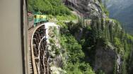 Stock Video Footage of Train exits tunnel with beautiful view
