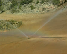Irrigating a golf course Stock Footage