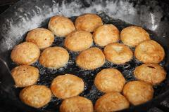 Indian pastries in a pan on the open market Stock Photos
