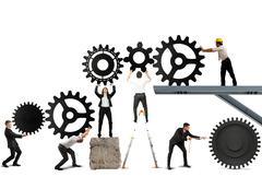 Teamwork works together to build a gear system Stock Illustration