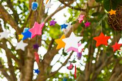 colorful candle stars on tree - stock photo