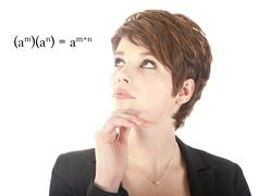 Young woman looking at mathematics isolated on white background Stock Photos