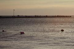 people walking on a pier - stock photo