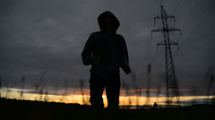 Silhouette of a man running on sunset Stock Footage