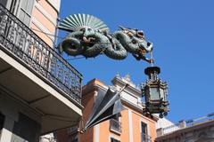 Dragon and umbrella of casa bruno cuadros, barcelona Stock Photos
