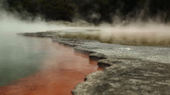 Steam and rocks in thermal pool Stock Footage