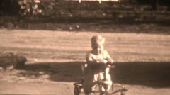 Old Vintage Film Black And White 1940s Blonde Little Boy Rides Toy Car Driveway Stock Footage