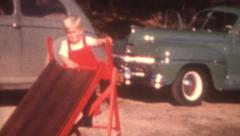 Old Vintage Film 1940s Little Boy Climbs Red Slide Blonde Park Play Fun Era Cars Stock Footage