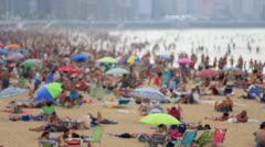 Soft focus summer crowd on beach Stock Footage