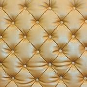 buttoned on the brown texture. repeat pattern - stock photo