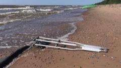 Pair crutch on sea beach sand and waves Stock Footage