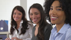 Close up of three business women smiling together in office - stock footage