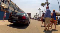 Police Squad Car Patrolling Venice Beach Boardwalk - stock footage