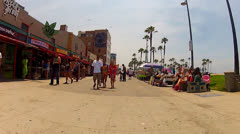 POV Camera Moves Down Venice Beach Boardwalk Past Shops 1 Stock Footage