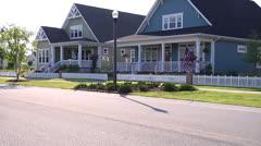 Neighborhood homes on street, dog walking, static @3600% (Leveled) Stock Footage