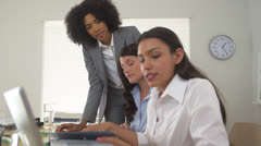 Hispanic, African, and Caucasian business women working together at computer - stock footage