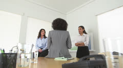 Rear view of African American business woman talking to co workers Stock Footage