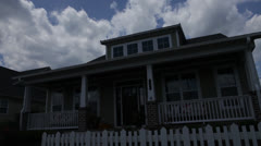 Stock Video Footage of Front of House, cloudy blue sky, alternating light dark, static @2800%