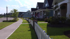 Neighborhood street, houses, fence, streetlight, flag, realtime - stock footage