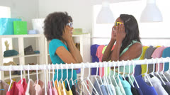 African American friends shopping and taking pictures with mobile phone Stock Footage