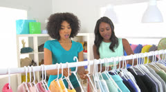 African American friends shopping and trying on clothes Stock Footage