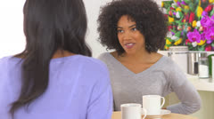 African American woman showing engagement ring to friend Stock Footage