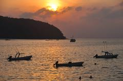 Zihua Boats At Sunset - stock photo