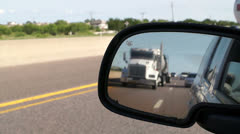 Highway travel through a side view mirror - stock footage