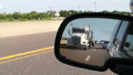Stock Video Footage of Highway travel through a side view mirror