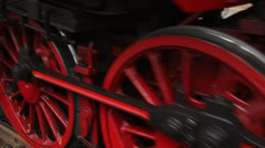 Steam locomotive close up red wheels turning + stops - full screen Stock Footage