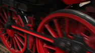 Stock Video Footage of Steam locomotive close up red wheels turning + stops - full screen
