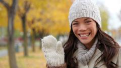 Fall woman looking to side then waving hello - stock footage