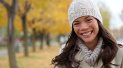 Fall woman portrait in autumn foliage city park Stock Footage