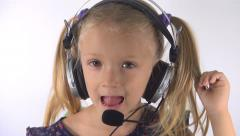 Portrait of Little Girl Singing Music, Child Playing with Headphones, Microphone Stock Footage