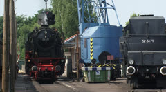 Loading steam locomotive with coal  at railway station, platform Stock Footage